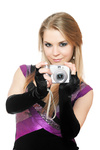 Attractive blonde holding a photo camera. Isolated on white