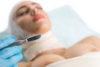 Bandaged girl at plastic surgeon breast operation