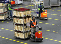 Mini-trucks hauling wagons with boxes of plants and flowers ready for shipment, Royal FloraHolland,