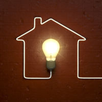 a light bulb building a house with the cable