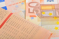 Close-up newspaper with of Euro banknotes