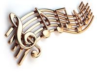 Golden music notes and treble clef on musical strings isolated on white.