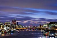 View from Tower Bridge on London Cityscape panorama at sunset with HMS Belfast in the foreground, and London Bridge