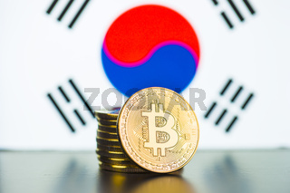 Golden bitcoins and South Korea flag.