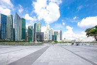 empty marble floor with modern buildings near water
