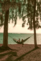Woman reading in hammock alone