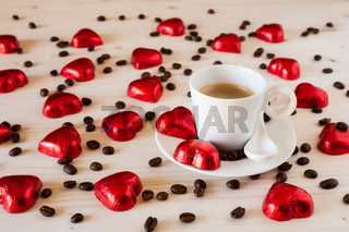 Chocolate hearts and coffee beans on a table
