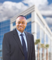 Handsome African American Businessman In Front of Corporate Building.