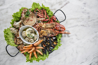 mixed fresh seafood selection gourmet set platter meal on table