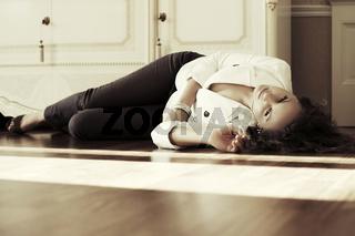 Sad beautiful fashion woman lying on the floor