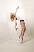 Sporty sexy blonde in top, pants and sneakers