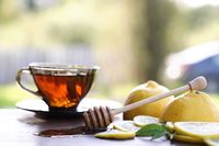 Fresh honey with a cup of black tea