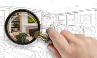 Hand Holding Magnifying Glass Revealing Custom Kitchen Design Drawing and Photo Combination