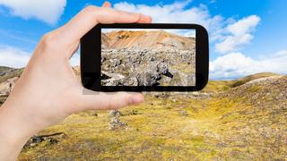 tourist photographs Laugahraun volcanic lava field