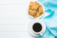 Sweet apple cookies and coffee cup.