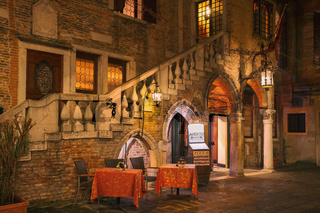The picturesque restaurant in the evening light in Venice, Italy