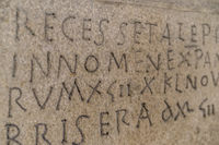 Script, ancient writing in latin and ancient spanish carved on the stone inside a gothic cathedral in spain