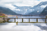 Girl sitting on a deck over a lake