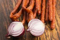 Snack stick sausage with onion