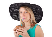 woman drinking coconut cocktail