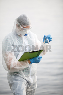 Ecologist with bulb and folder