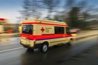 An ambulance of the German Red Cross in fast driving