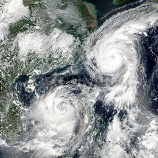 Typhoons Talim and Doksuri. Elements of this image furnished by NASA.