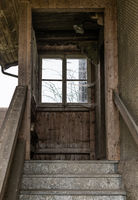 Stairs with entrance to abandoned residential and farmhouse - Lost Place
