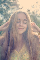 Defocused photo of happy smiling girl her eyes closed retro color