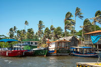 Fishing boats are waiting for a tide near the Cabure lighthouse in Lencois National Park