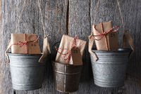 An Advent Calendar made of buckets with dated gifts inside.