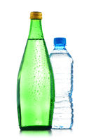 Two bottles of mineral water isolated on white background