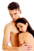 Young and fit caucasian adult couple in an embrace