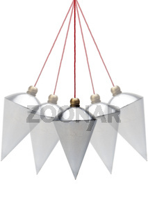 Plumb bob in motion on white background