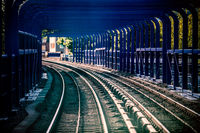 Train tracks in a tunnel on a bridge in London