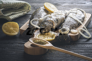Fresh trout with spices on a cutting board