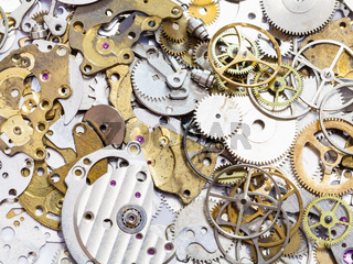 many old watch spare parts close up