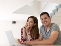 happy young couple buying online