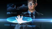 businessman touching virtual chart projection