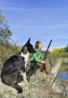 The girl-hunter with a dog in an ambush