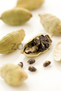 Green cardamom seed as closeup on white background