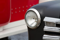 Close up headlight from a classic american car