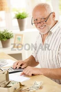 Portrait of senior man working at home