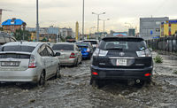 Cars driving in flooded streets after a thunderstorm, Ulaanbaatar, Mongolia