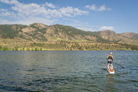 summer stand up paddleboard on lake in Colorado