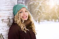 happy woman enjoying sunny day in winter