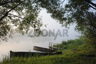 Boats in a morning fog