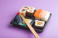 Eating set of sushi.