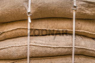 Background of stacked burlap sacks