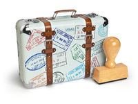 Travel or turism concept. Old suitcase with visa stamps isolated on white.